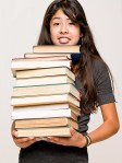book pile with teen girl